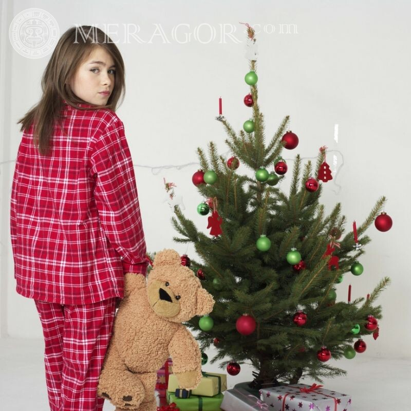 Girl near the Christmas tree icon